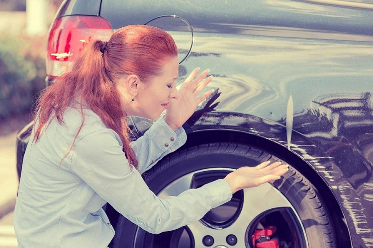 Woman Showing Scratch On Car