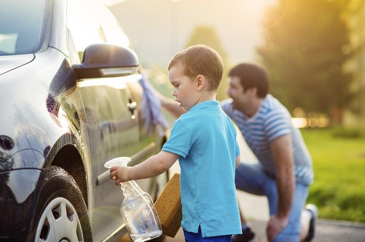 Dad And Son Washing Car